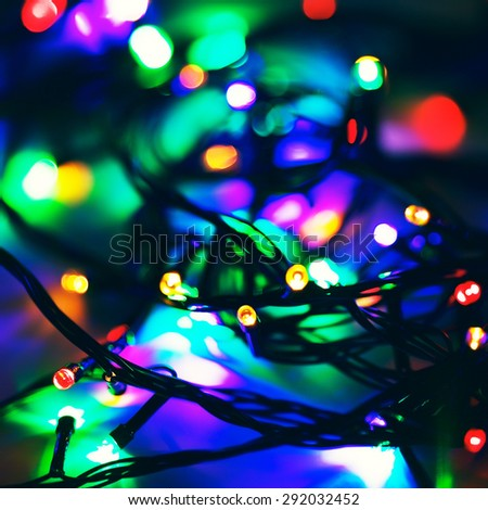 defocused electric garland with red, green and blue lights - stock photo