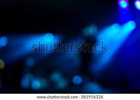Defocused entertainment concert lighting on stage, blurred disco party. - stock photo