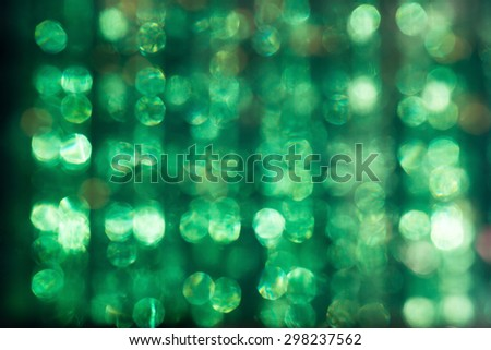 defocused glare of the sun through the Plexiglas abstract green background - stock photo