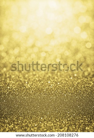 Defocused gold sparkle glitter lights background. Highlighted glitter bokeh background - stock photo