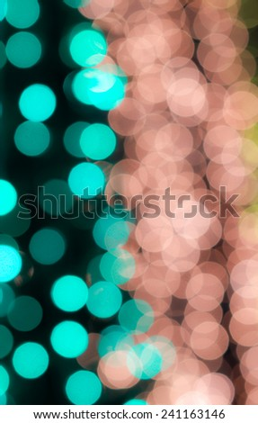 Defocused green brown bokeh lights glowing in the dark for holiday, Christmas and celebration for abstract background - stock photo