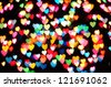 Defocused hearts on christmas light background - stock photo