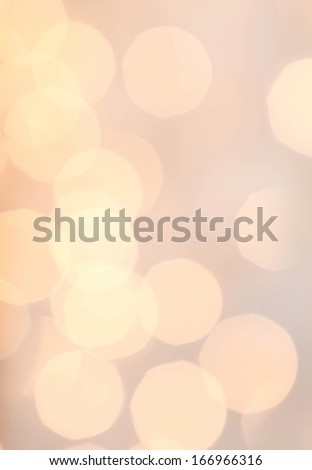 Defocused Holiday Bokeh twinkling lights Vintage background with golden lights in retro style. Warm yellow tonned.