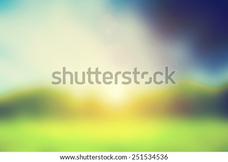 Defocused image, blur of fresh green spring summer landscape with sun shining. - stock photo