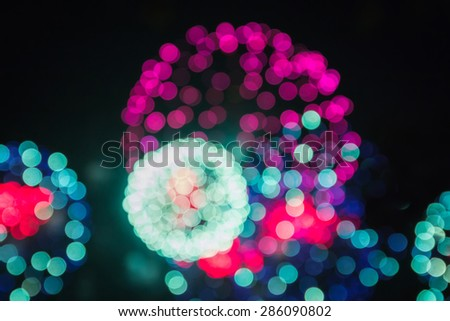 defocused image of fireworks, bokeh background, holiday background - stock photo
