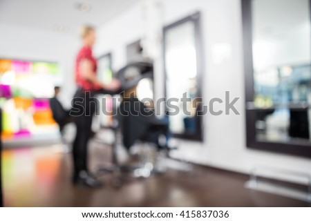 Defocused Image Of Hairdresser With Clients - stock photo