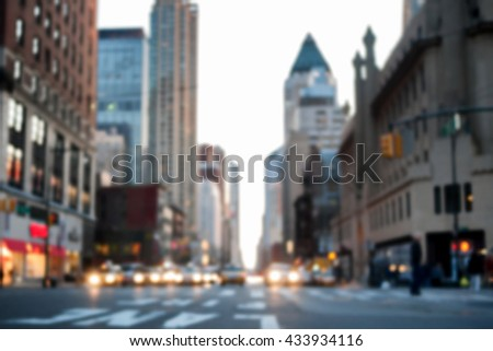 Defocused image of midtown 8th Avenue facing downtown, with cars and cabs at a red light