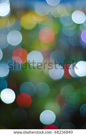 Defocused image of shone bulbs on a christmas-tree - stock photo