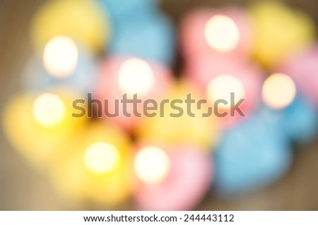 Defocused light of candles for Valentine's Day - stock photo