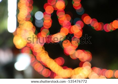 Defocused lights blurred background color of night light, Christmas and New Year season