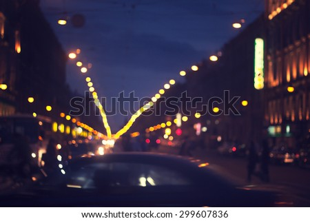 defocused night city life: cars, people and street lamps - stock photo
