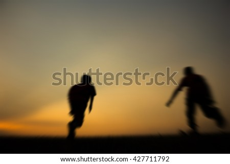 Defocused of Fitness on silhouette sunrise The boy running workout wellness concept. - stock photo