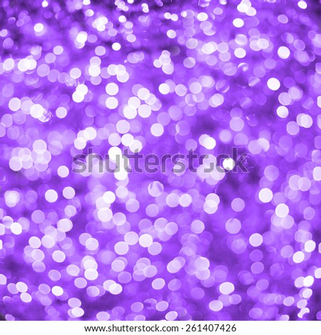 Defocused purple abstract christmas background of blurred lights with bokeh effect - stock photo