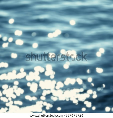 Defocused Sparkling water background / Blinking blue water for you design with natural bokeh - stock photo
