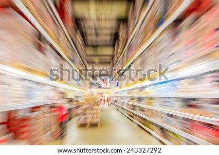 Defocused speed motion blur background of product shelf in department store. - stock photo