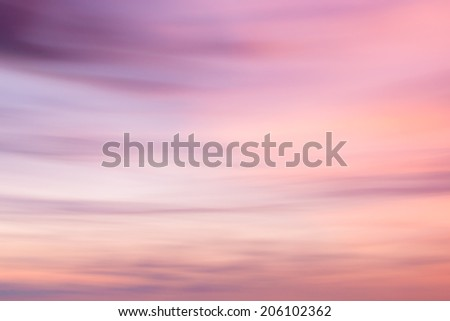 Defocused sunset sky  natural background with  with blurred panning motion. - stock photo