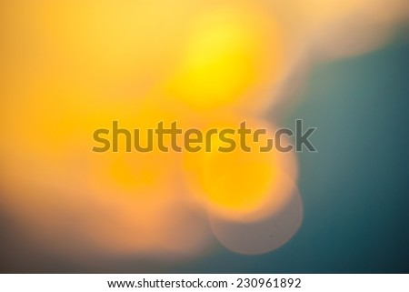Defocused sunset with beautiful blue sky - stock photo