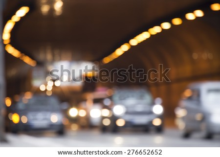 Defocused traffic lights in the tunnel - stock photo