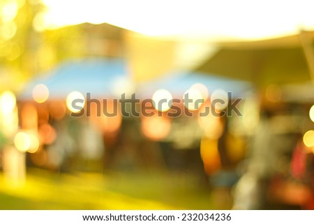 Defocused urban abstract texture bokeh city lights in the background with blurring lights for your design, vintage or retro color toned - stock photo