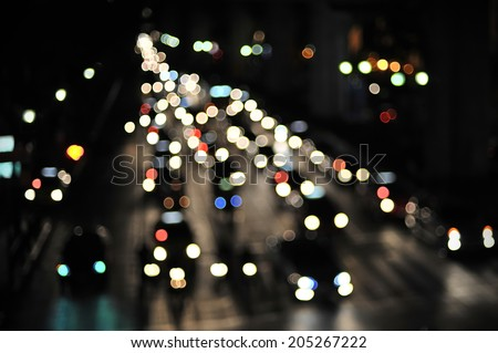 Defocused Vehicles Lights on a Busy City Road at Night - stock photo