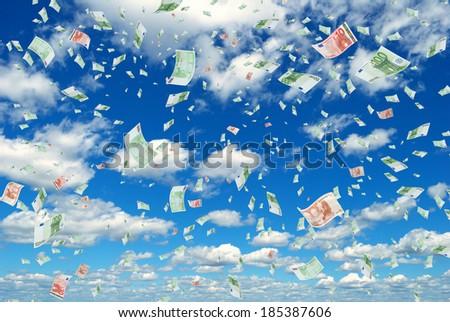 Deformed euro banknotes in flight in the sky. - stock photo