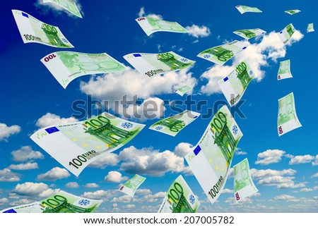 Deformed euro banknotes in flight on a blue sky background. - stock photo