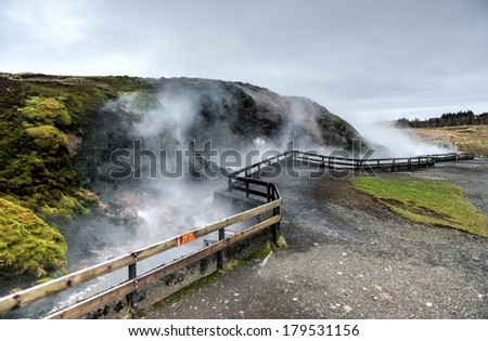 Deildartunguhver, a geothermal hotspring in Reykholtsdalur, Iceland. It has a very high flow rate for a hot spring and water emerges at near boiling. It is the highest-flow hot spring in Europe. - stock photo