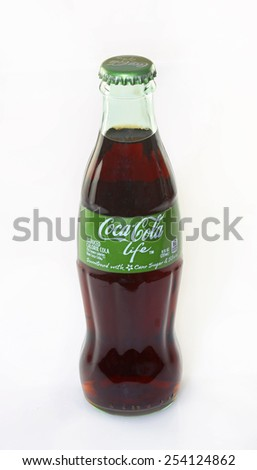 DELAND, FL - FEBRUARY 18, 2015: Coca-Cola Companys first reduced-calorie beverage sweetened with cane sugar and stevia leaf extract.  Packaged in 8 ounce glass bottles identified with a green label. - stock photo