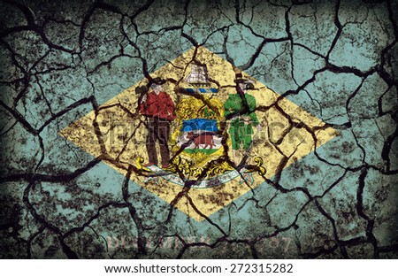 Delaware flag pattern on crack soil texture,retro vintage style - stock photo