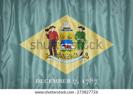 Delaware flag pattern with a peace on fabric texture,retro vintage style - stock photo