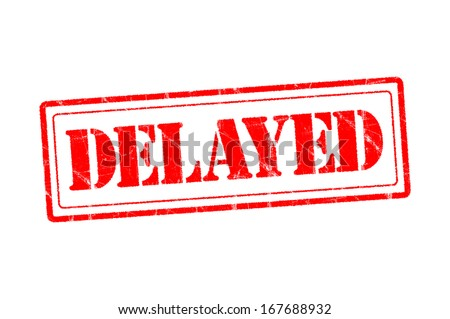 Delayed:rubber stamp of delayed warning sign  - stock photo