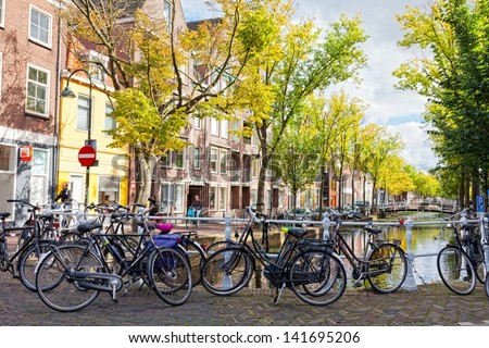 DELFT, NETHERLANDS - SEPTEMBER 27. Parking of bicycles on the bank of the channel in Delft, Nideranda, September 27, 2012. The population as of January 1, 2008 made 96 168 people