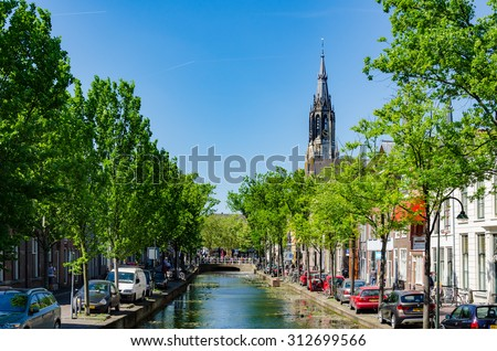DELFT,THE NETHERLANDS - APRIL 16: Canal in Delft on April 16, 2014 in the city of Delft , the Netherlands. Delft is known for its historic town centre with canals and a popular touristic destination. - stock photo