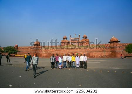 DELHI, INDIA - CIRCA MAY 2014: People visit Red Fort. Red Fort is a 17th century fort complex was designated a UNESCO World Heritage Site in 2007. It covers area of about 121.34 acres.  - stock photo