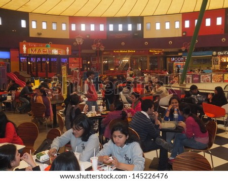 DELHI, INDIA - DECEMBER 9: Food Court at the Great India Place mall in Noida in Delhi, India, as seen on December 9, 2011. Great India Place is one of the largest operational malls in India. - stock photo
