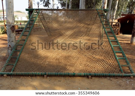 Delhi, India - December 26, 2015:  Sanjay Lake adventure park at New Delhi where children can enjoy tunnel climbing, burma bridge, rope bridge, tree- rope climbing etc. adventure games.