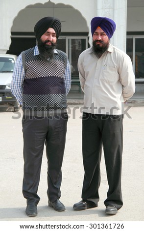 DELHI, INDIA - FEBRUARY 18, 2015: two sikhs look somewhere in Delhi, India - stock photo
