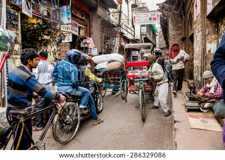 DELHI , INDIA - JANUARY 24, 2015: Crowded Indian side street in Old Delhi, India. - stock photo