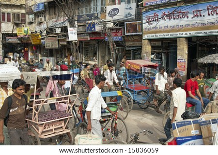 DELHI, INDIA - JULY 18: Unidentified people in a typical street in Old Delhi. July 18, 2008 in Delhi, India. - stock photo