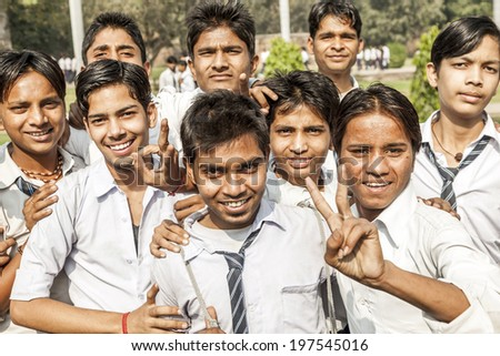 DELHI, INDIA NOV 11, 2011: unidentified school class visits Humayuns tomb in Delhi, India. The boys in school uniform have fun posing for a foto. Schools visit the famous landmarks as part of national education.
