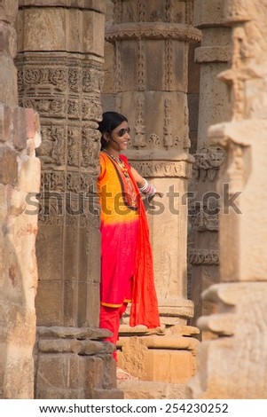 DELHI, INDIA - NOVEMBER 4: Unidentified woman stands in Quwwat-Ul-Islam mosque courtyard at Qutub Minar complex on November 4, 2014 in Delhi, India. Qutub Minar is the tallest minar in India.