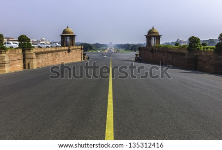 Delhi, India. View of the main thoroughfare, Rajpath, between the Houses of Parliament and India Gate (as seen on the horizon) on a bright sunny morning in New Delhi. - stock photo