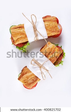 deli sandwiches in paper wrap /top view - stock photo