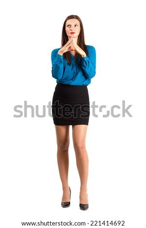 Deliberating young business woman with aligned fingers. Full body length isolated over white background. - stock photo