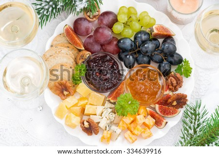 delicacy cheese and fruit plate to the holiday, closeup top view, horizontal - stock photo
