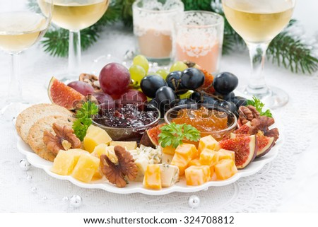 delicacy cheese and fruit plate to the holiday, horizontal - stock photo