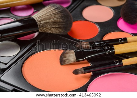 Delicacy of make-up is behind the usage of the right types of brushes for exact facial areas and the choice of professional products of high quality. Close-up still life. - stock photo