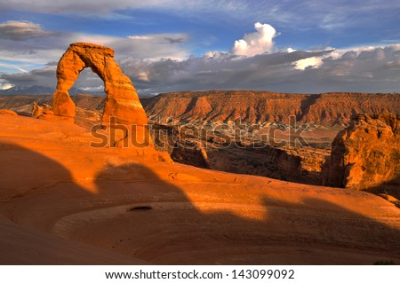 Delicate Arch against Beautiful Sunset Sky - stock photo