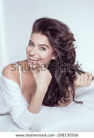 Delicate brunette beauty woman posing with toothy smile, natural makeup. - stock photo