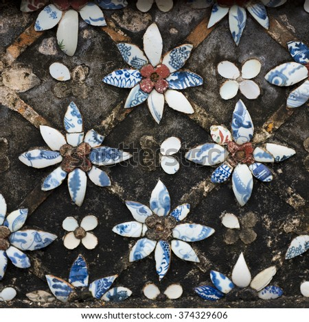 Delicate ceramic and mortar mosaic flower motifs in the Imperial City, the Citadel, Hue, Vietnam - stock photo